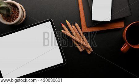 Digital Tablet Mockup And Smartphone Mockup With Accessories In Black And Orange Colour, Black Backg