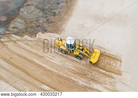 Aerial View Of The Working Earth Mover Grader Flattens The Surface