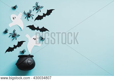 Witchcraft Pot With Ghosts, Bats, Spiders On Blue Background. Happy Halloween Banner Design. Flat La