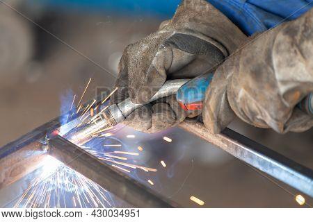 Worker Welding Metal, Close Up/ Construction Industry