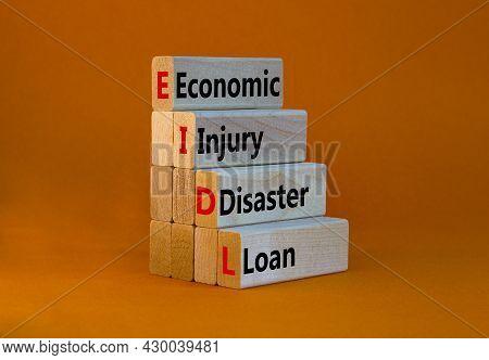 Eidl Symbol. Abbreviation Eidl Economic Injury Disaster Loan On Wooden Blocks. Beautiful Orange Back
