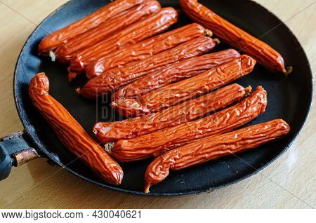 A Pan Of Hunting Sausages On A Beige Table. A Portion Of Ready-to-eat Food. Fried Sausages. Selectiv