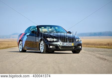 Berlin - April 2014: : Bmw 3 Series E93 328i Convertible With M-pack Logo Stripes Outdoors. Open Roo