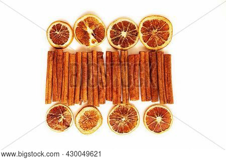 Cinnamon Sticks And Dried Grapefruits And Oranges In Slices On A White Background. Grocery Backgroun