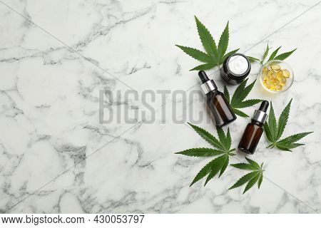 Composition With Cbd Oil, Thc Tincture And Hemp Leaves On White Marble Table, Flat Lay. Space For Te