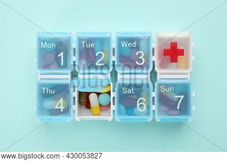 Pill Box With Medicaments On Turquoise Background, Top View