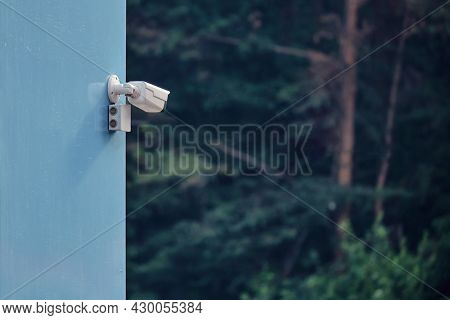 A Video Surveillance Camera On The Building Monitors The Forest, Monitoring The Safety Of Parks And