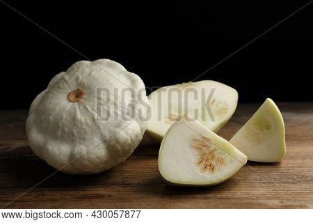 Whole And Cut White Pattypan Squashes On Wooden Table Against Dark Background