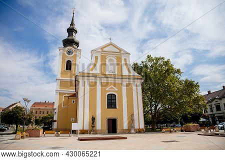 Hodonin, South Moravia, Czech Republic, 03 July 2021: Baroque White And Yellow Church Of St. Lawrenc