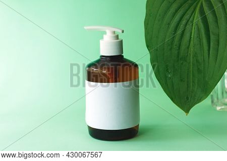 Amber Glass Cosmetic Bottle Mockups. Pump Bottle With Natural Hand Cream. Cosmetic Product Packaging