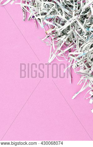The Shredded Paper On Light Pink Background.