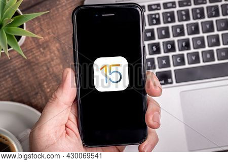 Antalya, Turkey - August 17, 2021. Iphone With The Logo Of The New Ios 15, Apple's Next Operating Sy