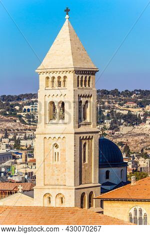 Sunset. Bird's eye view. Bell tower and golden crosses in christian quarter. The roofs of Jerusalem. The concept of historical, religious, pilgrim and photo tourism
