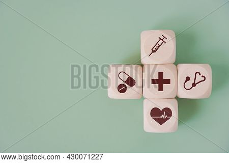 Wood Cube With Medical Symbol On Green Background With Copy Space For  Health Medical Insurance, Ann