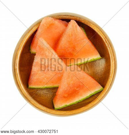 Watermelon Slices, In A Wooden Bowl. Triangular And Ready-to-eat Pieces Of A Freshly Cut, Ripe And S