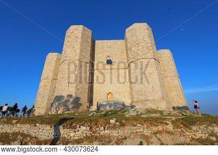 Andria, Italy - June 4, 2017: People Visit Castel Del Monte In Italy. Castel Del Monte Is A Medieval
