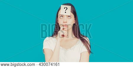 Doubtful Girl Asking Questions To Himself. Paper Notes With Question Marks. Confused Female Thinking