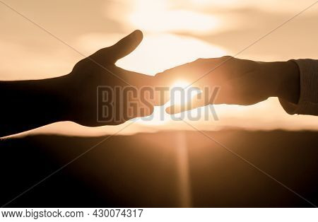 Help Hand, Silhouette, Concept Help. Giving A Helping Hand. Rescue, Helping Gesture Or Hands. Two Ha