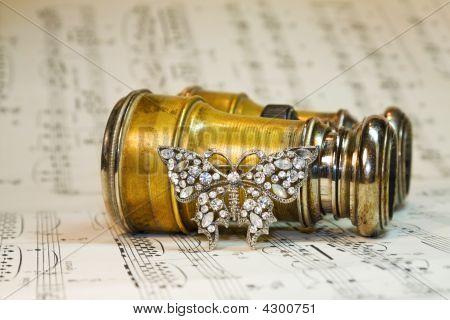 Antique Theater Binoculars Over Classic Music Notes