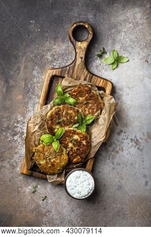 Zucchini And Parmesan Fritter With Greek Tzatziki Sauce