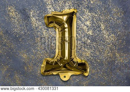 The Number Of The Balloon Made Of Golden Foil, The Number One On A Gray Background With Sequins. Bir