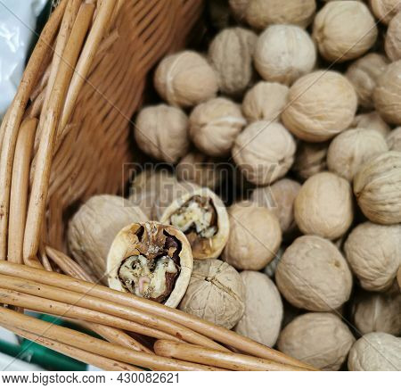 Closeup Of Rotten, Infected Walnut Halves With A Worm In A Supermarket On A Shelf