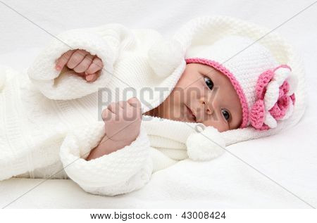 Little Baby In Knitted White Hat