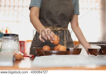 Woman Chef Pick Up Fresh Raw Egg Preparing Ingredient For Making Healthy Cuisine