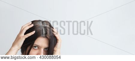 Fragments Of Gray Hair On The Head Of A Young Woman. Early Gray Hair Concept. Gray Hair Color And St