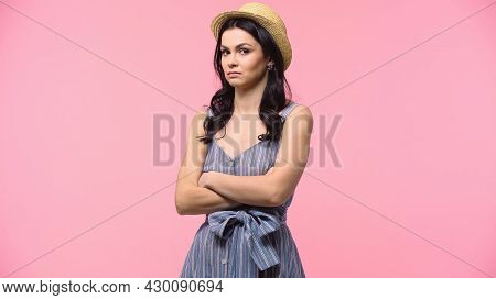 Offended Woman In Straw Hat Looking At Camera Isolated On Pink.