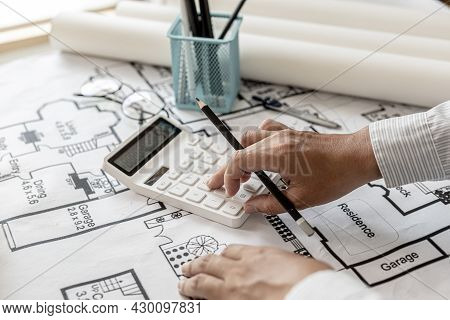 The Architects Pressed A Calculator To Calculate The Area In A Blueprint, Designing The House Accord