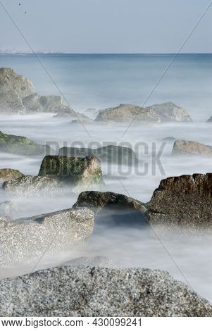Rocks In The Seashore With A Long Exposure And Silky Water