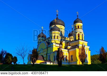Orthodox Church Painted In Yellow . Monastery Hincu , Famous Place Of Worship In Moldova