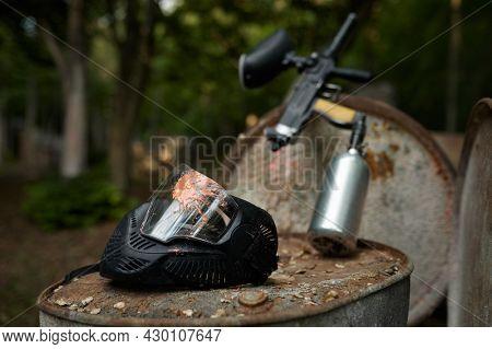 Paintball gun and protection mask closeup