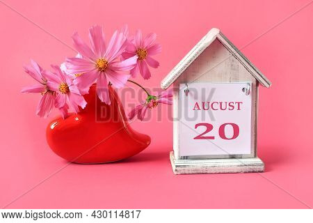 Calendar For: August 20 : The Name Of The Month Of August In English With The Number 20 On A Toy Hou