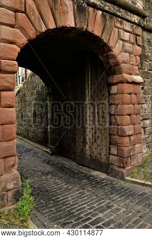 A View Of An Old Stone Archway Through The Curtain Perimeter Wall Which Surrounds The Northumberland