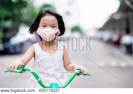 Child Wearing Cloth Face Mask During Coronavirus (covid-19) Pandemic Outbreak For Protection Spread.