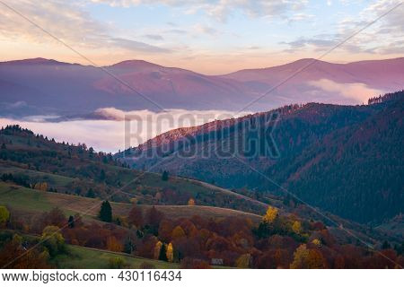 Mountainous Countryside In Autumn At Sunrise. Beautiful Scenery With Rural Fields On Hills Rolling I