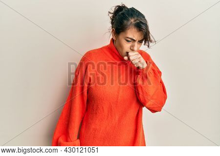Young hispanic woman wearing casual winter sweater feeling unwell and coughing as symptom for cold or bronchitis. health care concept.