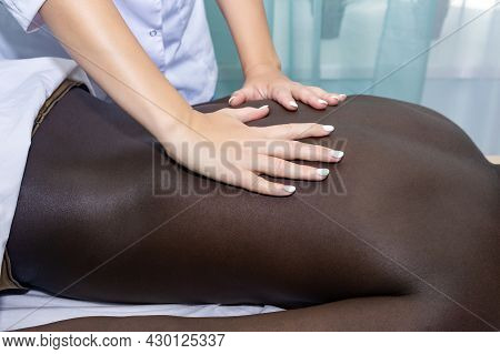 Chiropractor Or Masseuse Woman Hands During Work Close Up