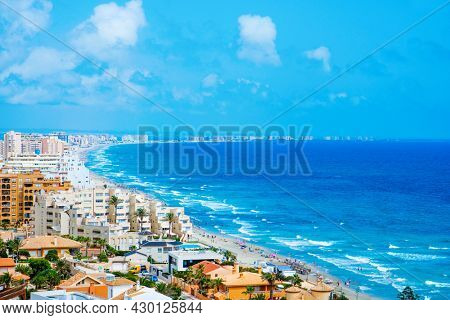 LA MANGA, SPAIN - JULY 29, 2021: A panoramic view over the southeast side of La Manga del Mar Menor, in the Region of Murcia, Spain. It is an important summer tourist destination in Spain