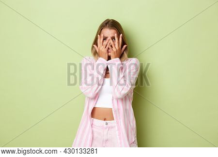 Image Of Young Caucasian Woman With Blond Hair, Feeling Scared, Standing Startled And Cover Eyes Wit
