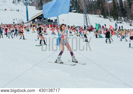 Grelka Fest Is A Sports And Entertainment Activity For Ski And Snowboard Riders In Bikini. Woman In