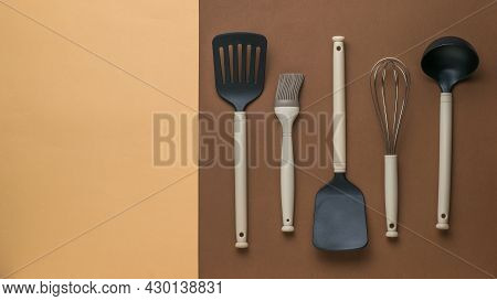 Plastic Kitchen Utensils For Cooking On A Two-color Background. Plastic Kitchen Tools. Flat Lay.