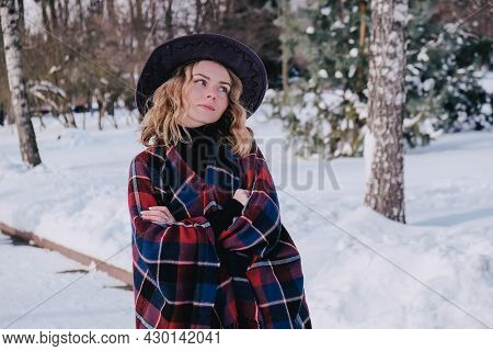 Young Woman Enjoying Winter Weather In The Snow Park. Cold Weather. Winter Fashion, Holidays, Rest,