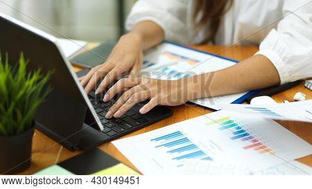 Closeup Businesswoman Hands , Working With Smart Tablet And Financial Documents