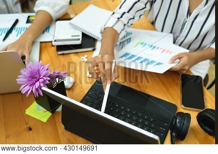 Business Team Working And Calculating For New Business Investment