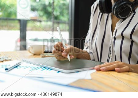 Female Freelancer Work With Digital Tablet, Stylus Pen, Headphone