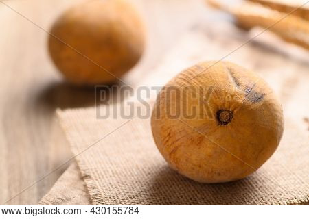 Ripe Santol Fruit On Wooden Table, Tropical Fruit In Southeast Asia