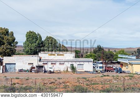 Richmond, South Africa - April 2, 2021: A Street Scene, With A Vehicle Workshoip, In Richmond In The